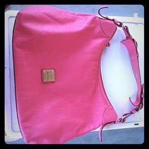 A Dooney & Bourke 1975 purse pink